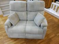 2 seater cream fabric sofa with cushions
