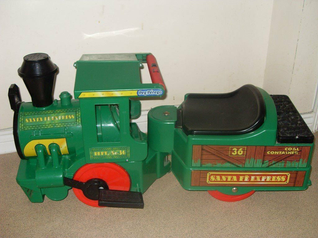 Childs Battery powered sit-on Train