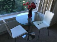 Glass dining table x 2 chairs included