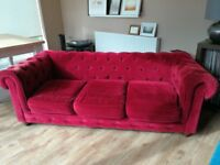 Dark red velvet Chesterfield sofa