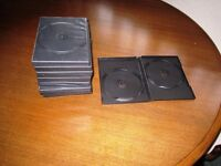 12 DVD cases each holding 2 CD's