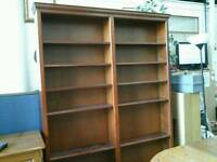 Tall brown double wide bookcase