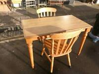 Pine table and two beech chairs