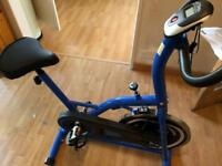 F4H ES-702 INTENSIVE OLYMPIC INDOOR CYCLING EXERCISE BIKE