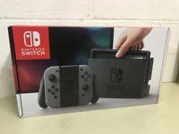 Brand new Nintendo switch, grey colour controllers