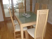 Dinning room table with 6 chairs and a display cabinet