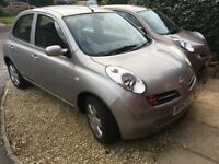 low mileage very clean car in silver