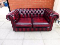 Oxblood red leather chesterfield two seater sofa