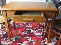 Vintage Small wood table and two matching wooden chairs.