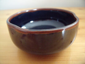Attractive highly glazed dark blue/brown dish with 'pinched' rim detail.