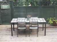Solid wood / rust free framing table and 4 chairs. £80