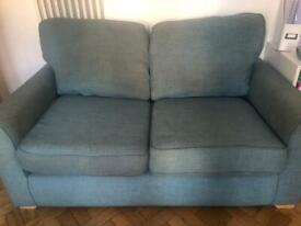 Blue 2-seater sofa with footstool