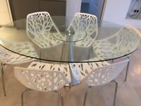 Attractive glass table and chairs fabulous condition from a pet free and smoke free home