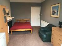 Next to The station. Really good size double room. All bills included