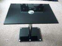 Adjustable glass table