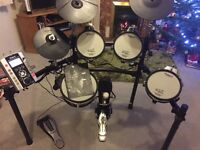 Fully functional hardly used drumkit, 50 different built in sound variations, users manual included.