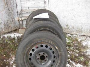 4 Winter Claw 225-60-17 Extreme Grip Tires on rims