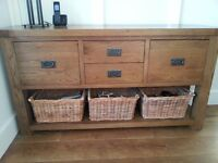 Reclaimed oak sideboard/hall table with drawers. Includes rattan wicker baskets