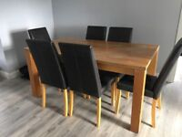 Solid oak table and 6 brown Leather chairs