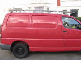 Roof Rack for Toyota Hi Ace SWB made by Bolton Roof Racks, with rolling load bar.