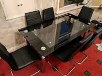 Double glass dinning table with 6 leather chairs