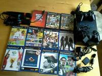Ps2 + 2 Controllers + games