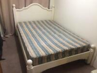 Pine double bed with a mattress