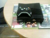 Xbox 360s slim 320gb with 8 games and official wireless pad