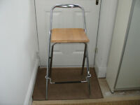Folding Bar stool Beech and Chrome. I think it is John Lewis Verona style.