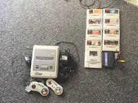 SNES console+rare games(Zelda,Mario,Street Fighter,Metroid etc.) plus NES and Gameboy Adaptors