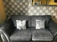 Black sofas and matching footstool