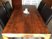 8 seating, dark wooden dining room table & 4 leather chair s, good quality, hardly