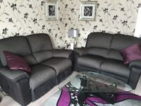 Top quality DFS double two seater sofas and footstool, one electric recliner and one manual.