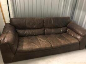 Large brown distressed leather sofa and foot stool