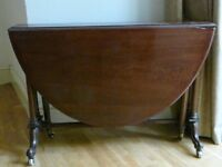 Drop leaf mahogany dining table