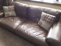 Brown leather sofa and snuggle chair-used