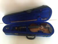 Violin with case and book