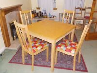 IKEA DINING TABLE AND FOUR CHAIRS, EXTENDABLE, SEATS UP TO EIGHT.