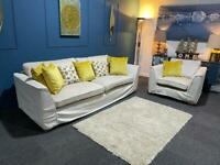 Large cream fabric suite . 4 seater sofa and chair