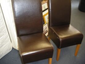 2 LEATHER-EFFECT DINING CHAIRS
