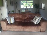 Two Brown DFS Leather 3 Seater sofas