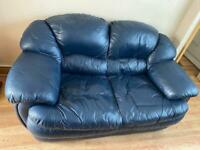 Two seater blue leather sofa