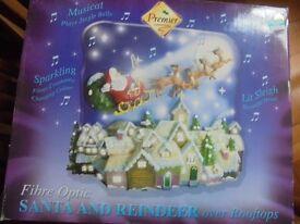 Musical Fibre Optic Santa & Reindeer over rooftops Plays Jingle Bells and lights change colour