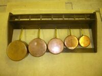 Old French kitchen sauce pan rack with 5 matching sauce pans