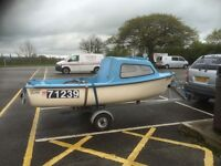 Fishing boat with 10 horse outboard Yamaha road trailer and tail board 13 ft long