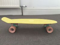 Authentic Penny Skateboard in yellow. Very good condition