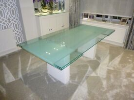 Stunning Glass Extending Dining Table. Frosting effect down the middle. Seats 10 when Extended.
