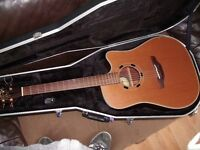 Takamine made in Japan electro acoustic guitar with Gator hard case