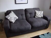 Pair of 2 seater sofas, with matching storage footstool. Dark grey fabric.