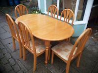Extending Dining Table and 6 Chairs in Very Good Condition